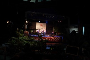 Dzaydzorm and band performing from a distance at The Cadence
